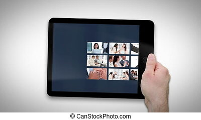 Animated tablet computer displaying videos about...