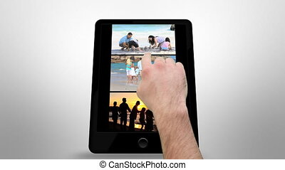 Animated tablet computer showing family outdoor with copy...