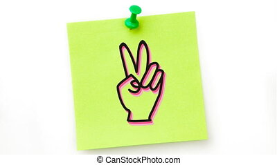 Animation of a black hand icon flickering on green sheet of paper pinned on white background