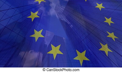 EU flag with modern office buildings in the background