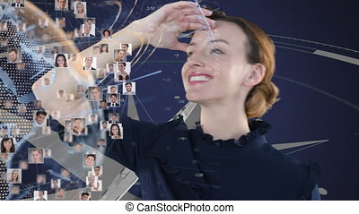 Animation of a Caucasian woman looking at a globe spinning with people pictures on it