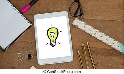 Animation of a digital tablet showing drawing of a light bulb on the screen