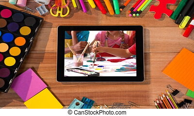 Animation of a digital tablet showing multi-ethnic group of ...
