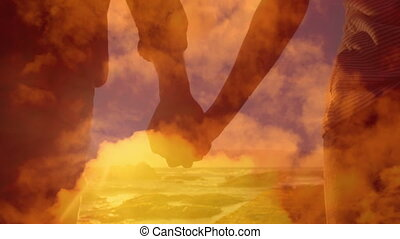 Animation of a happy couple holding hands walking on a beach by sea with orange clouds.