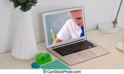 Animation of a laptop showing Caucasian boy on the screen