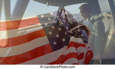 Animation of American flag waving over mixed race couple in car using smartphone by seaside