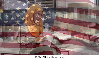 Animation of American flag waving over mixed race woman in ...