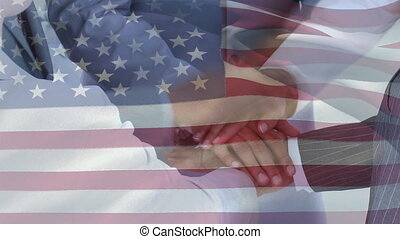 Animation of American flag waving over multi ethnic ...