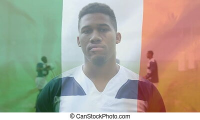 Animation of an Italian flag waving over an African American male rugby player portrait