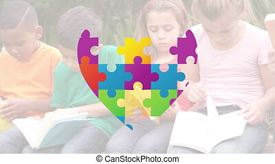 Animation of Autism Awareness Month symbol with children reading books