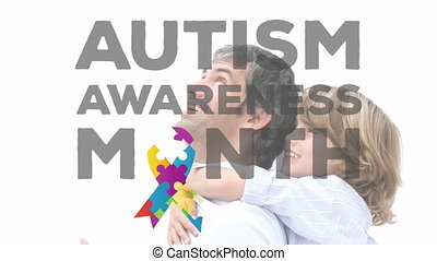 Animation of Autism Awareness Month symbol with father ...