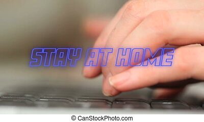 Animation of blue neon words Stay At Home over hands typing ...