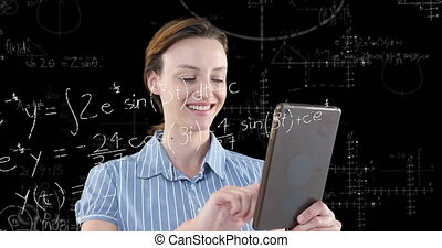Animation of a Caucasian woman using her tablet with floating mathematics formulae on black background. Global economy and technology concept digital composite