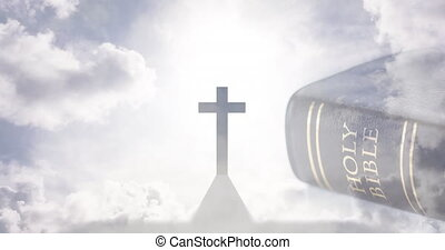 Animation of christian cross and holy bible with sun and clouds