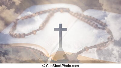 Animation of christian cross, rosary and holy bible over clouds