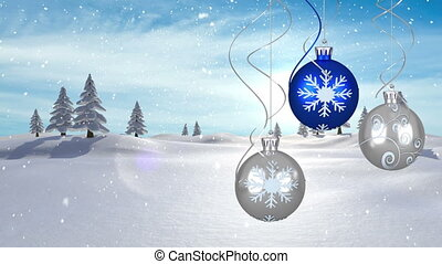 Animation of christmas blue and silver baubles hanging with snow falling and winter landscape on blue background. christmas festivity celebration concept digitally generated image.