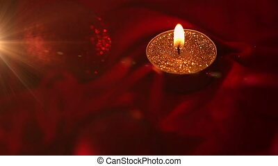Animation of christmas red bauble decoration and candle. christmas festivity celebration concept digitally generated image.