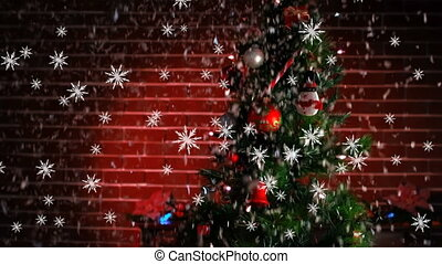 Animation of christmas tree and snow falling against red brick wall