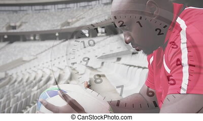Animation of clock ticking over African American male rugby ...