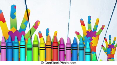 Animation of colourful crayons over hands formed with puzzles. autism and learning difficulties awareness and support concept digitally generated video.