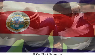 Animation of Costa Rican flag waving over multi-ethnic male rugby team
