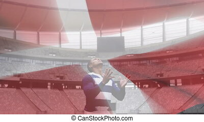Animation of Danish flag waving over mixed race male rugby player catching a ball digital composition