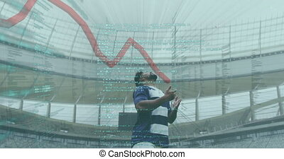 Animation of data and graph over mixed race male rugby player catching a ball digital composite