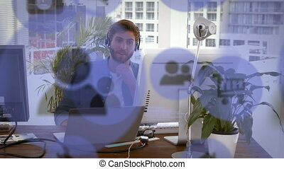 Animation of digital online shopping icons over man with phone headset using computer