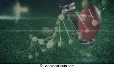Animation of DNA strand spinning with rugby player kicking a ball