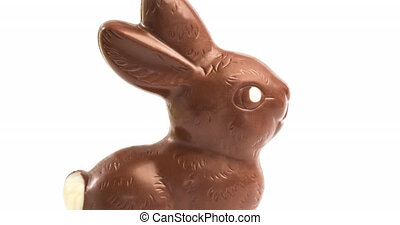Animation of easter chocolate bunny moving over white background