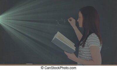 Animation of female school teacher writing mathematics formulae on blackboard holding a book. Education back to school and schooling concept digitally generated image.