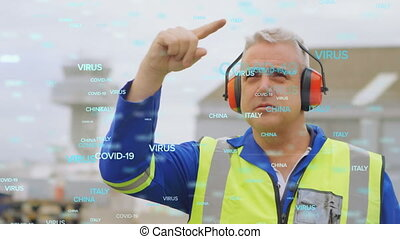 Animation of floating Covid-19 words over Caucasian male air traffic controller at airport. Public transport reopening with social distancing during Covid-19 coronavirus pandemic concept.