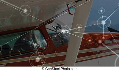 Animation of global network of connections and data processing air traffic control system, with aeroplane in the airport in the background. Global connections travel concept digital composite.