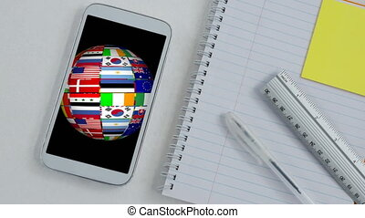 Animation of globe made of flags spinning in a phone screen