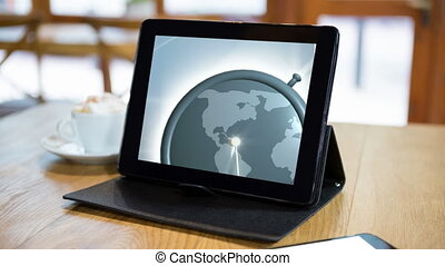 Animation of globe spinning on a touch pad screen - ...