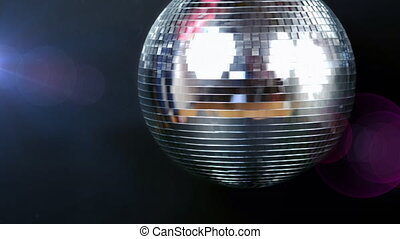 Animation of glowing and sparkling mirror disco ball ...