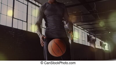 Animation of golden dots floating over man playing with a ball