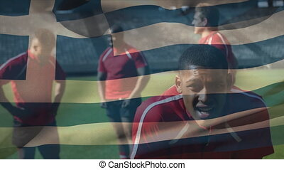 Animation of Greek flag waving over multi-ethnic male rugby team standing on a pitch