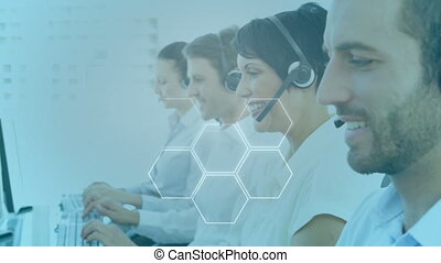 Animation of group of multi-ethnic call centre workers wearing headsets and using computers in office over social icons appearing. Work communication technology concept digitally generated