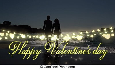 Animation of Happy Valentines Day written with string of fairy lights and couple in love by the sea in summer holding hands in the background. Valentines Day celebration concept digital composite.
