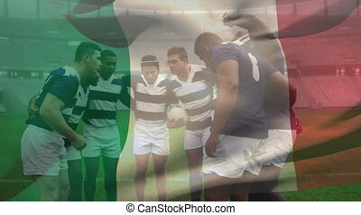 Animation of Italian flag waving over multi-ethnic male rugby team standing in a huddle digital composition