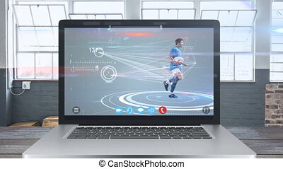 Animation of laptop computer showing a male rugby player catching a ball. Coronavirus spreading.
