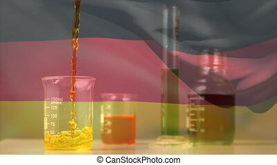 Animation of liquid falling into a test tube over German flag waving. Public health pandemic coronavirus Covid 19 social distancing and self isolation in quarantine lockdown concept digital composite