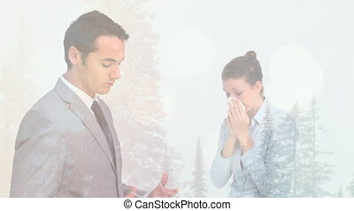 Animation of man putting face mask woman coughing against winter scenery. sickness and christmas during coronavirus pandemic concept digitally generated image.