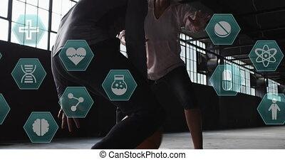 Animation of medical icons over man and woman playing basketball