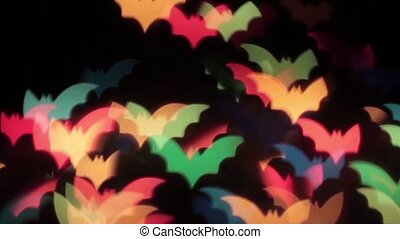 Animation of movement of multicolored bats on a black background HD 1920