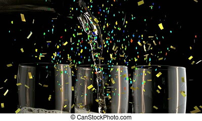 Animation of multi coloured confetti falling over pouring champagne. new years eve party festivity celebration concept digitally generated image.