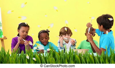 Animation of multi-ethnic group of children decorating ...