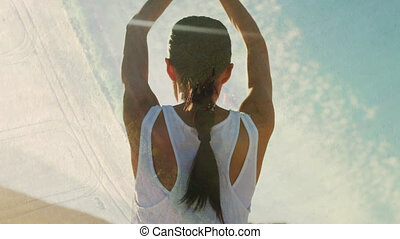 Animation of networks of connections over woman practicing yoga outdoors