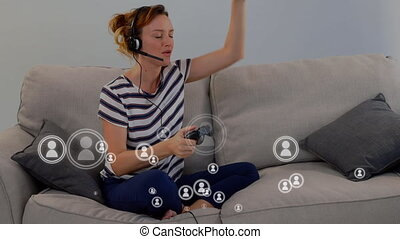 Animation of people icons flying over a woman playing a video game at home